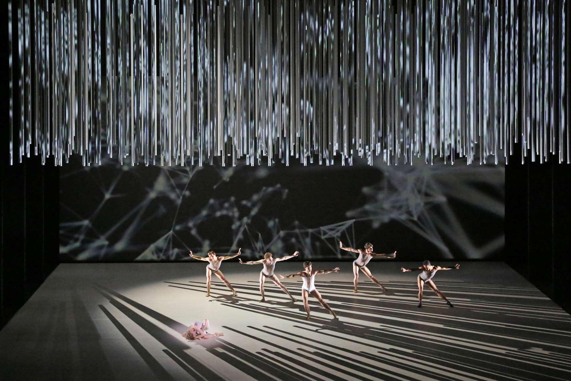 Es Devlin's Connectome set for The Royal Ballet - dancers on stage in light and sharp shadows